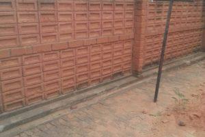 Fenced wall with standard bricks